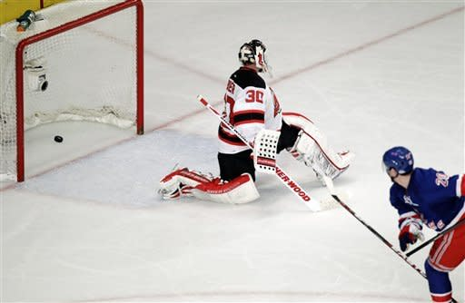 New York Rangers' Chris Kreider, right, scores a goal on New Jersey Devils goalie Martin Brodeur during the third period of Game 1 of their NHL hockey Stanley Cup Eastern Conference final playoff series, Monday, May 14, 2012, at New York's Madison Square Garden. (AP Photo/Julio Cortez)