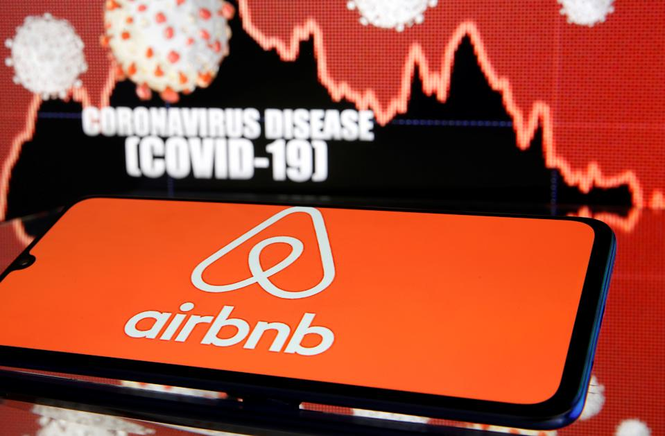Airbnb logo is seen in front of diplayed coronavirus disease (COVID-19) in this illustration taken March 19, 2020. REUTERS/Dado Ruvic/Illustration