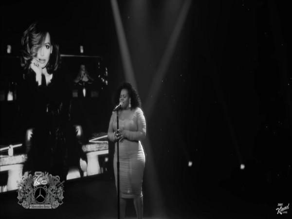 A still from the show featuring Amber Riley paying tribute to Naya Rivera (Image source: YouTube)