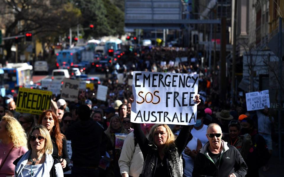 Protesters march through the city centre during an anti-lockdown rally as an outbreak of the coronavirus disease - Reuters