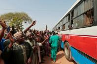 People gather to receive their sons, who have been rescued by the Nigerian security forces in Katsina