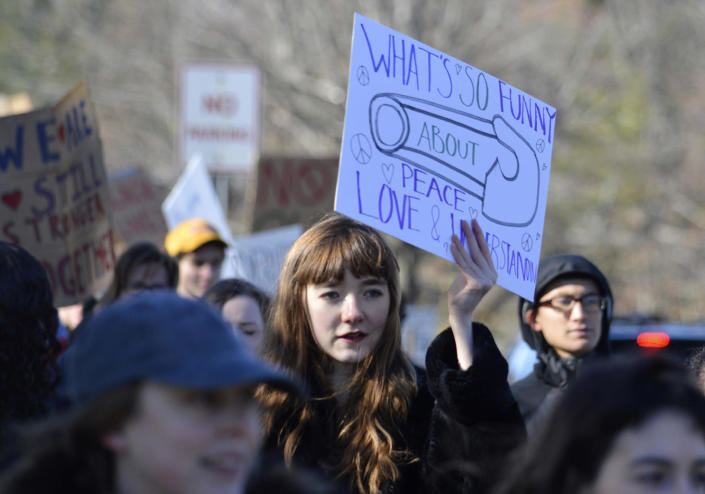 <p>Baladine Pierce, a freshman at Williams College, offers support during a protest against the election of Donald Trump on Saturday, Nov. 12, 2016 in WIlliamstown, Mass. (Ben Garver/The Berkshire Eagle via AP) </p>
