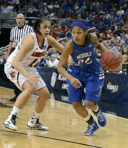 Middle Tennessee's Kortni Jones, right, drives around the defensive pressure of Louisville's Shoni Schimmel during the first half of a first-round game in the women's NCAA college basketball tournament in Louisville, Ky., Sunday, March 24, 2013. Louisville defeated Middle Tennessee 74-49. (AP Photo/Timothy D. Easley)