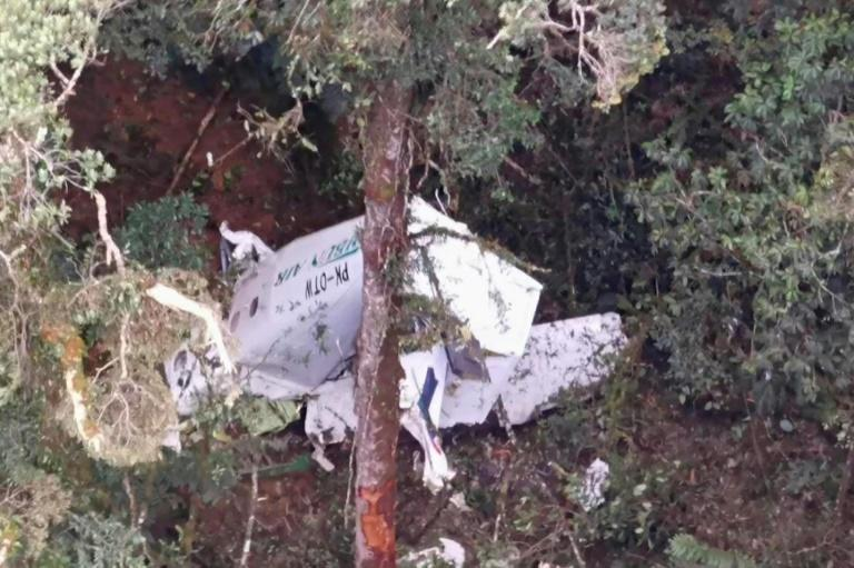 The wreckage of the Rimbun Air plane was found by locals over three hours later near a village in Papua's highlands (AFP/Handout)