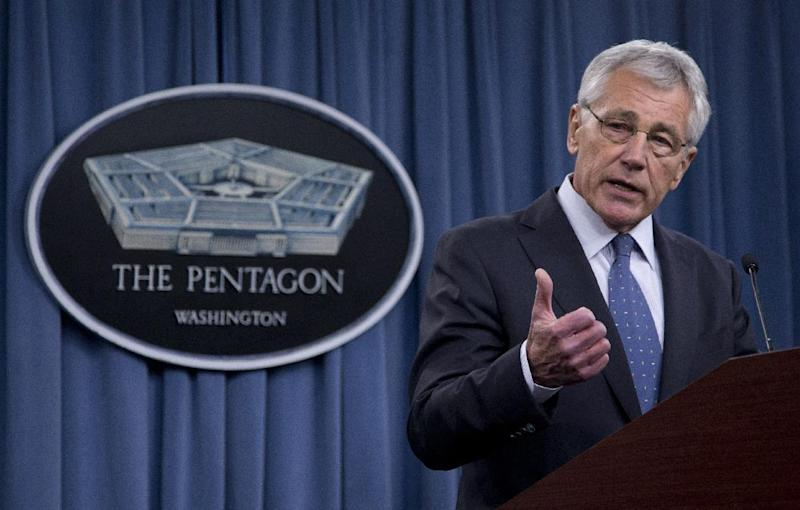 FILE - In this Feb. 24, 2014 file photo, Defense Secretary Chuck Hagel briefs reporters at the Pentagon. President Barack Obama has ordered the Pentagon to plan for a full American withdrawal from Afghanistan by the end of this year should the Afghan government refuse to sign a security agreement with the US the White House said Tuesday. (AP Photo/Carolyn Kaster, File)