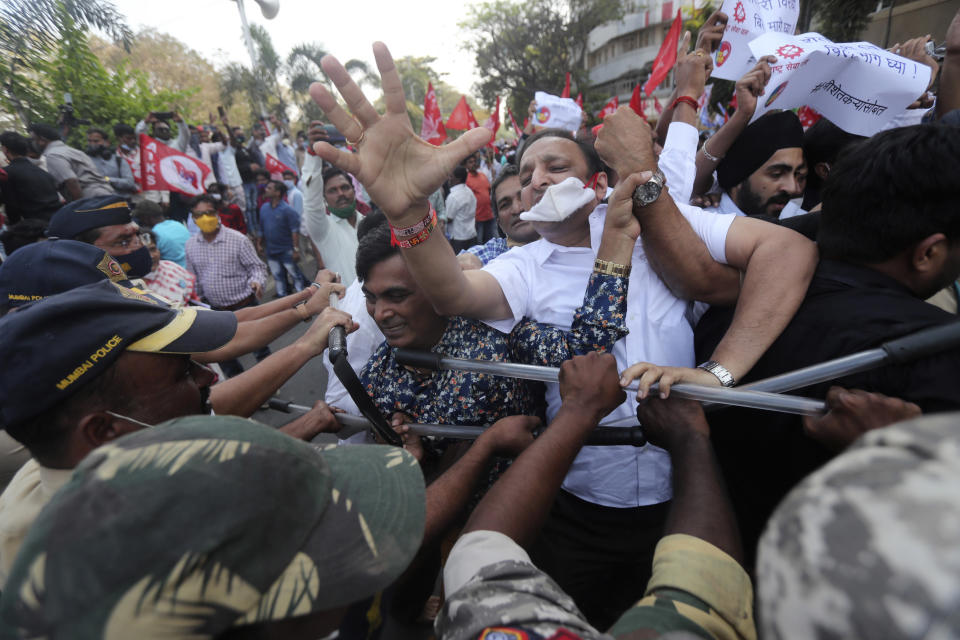 Police form a barricade against protesting farmers as they march in Mumbai, India, Monday, Jan. 25, 2021. Farmers have been protesting to press the Indian government to suspend contentious agricultural reform laws. (AP Photo/Rafiq Maqbool)