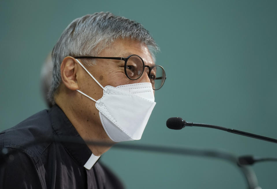 Stephen Chow Sau-yan listens to reporter's questions during a press conference in Hong Kong Tuesday, May 18, 2021. Pope Francis on Monday named a new bishop for Hong Kong, tapping the head of his own Jesuit order in the region, the Rev. P. Stephen Chow Sau-Yan, for the politically sensitive position that has been vacant for two years. (AP Photo/Vincent Yu)