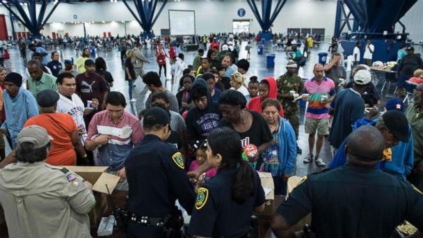 PHOTO: Flood victims gather for food at a shelter in the George R. Brown Convention Center during the aftermath of Hurricane Harvey, August 28, 2017, in Houston, Texas. (Brendan Smialowski/AFP/Getty Images)