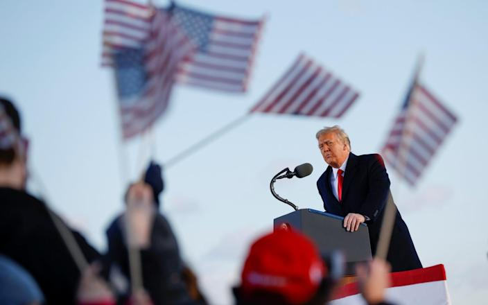 U.S. President Donald Trump speaks at the Joint Base Andrews, Maryland - CARLOS BARRIA/REUTERS