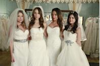 <p>No, the Liars didn't get married—they were just modeling dresses for a charity fashion show in season 4. But each look perfectly reflected each character's personality, from Spencer's classic, no-fuss number to Emily's romantic, show-stopping lace gown with cap sleeves. </p>