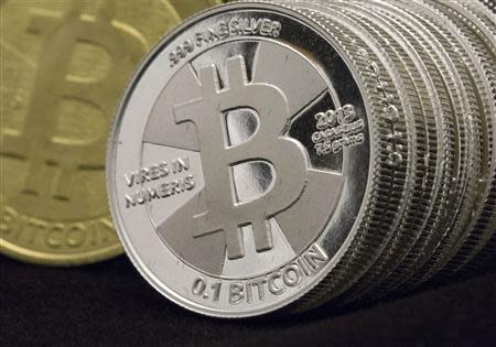 Some of Bitcoin enthusiast Mike Caldwell's coins are pictured at his office in this photo illustration in Sandy