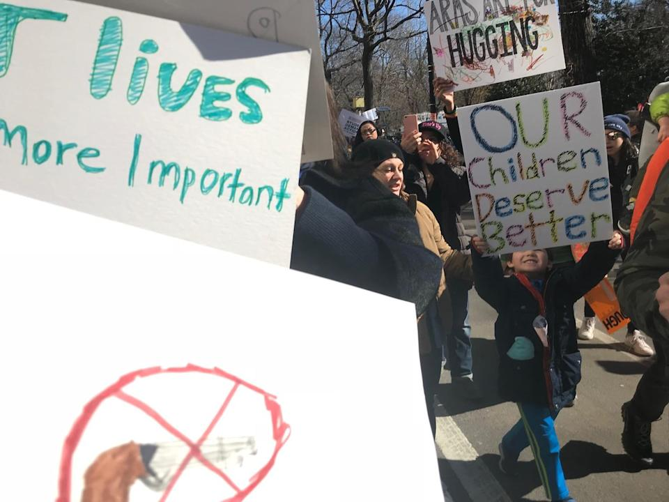 <p>Children hold up homemade signs in NYC. (Photo: Laura Kenney for Yahoo Lifestyle) </p>