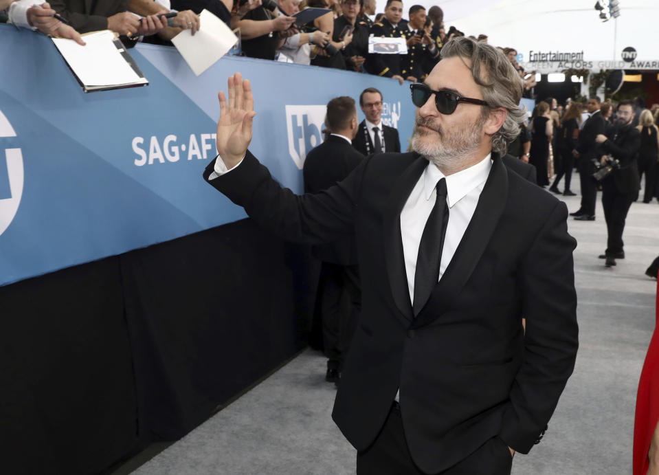 Joaquin Phoenix arrives at the 26th annual Screen Actors Guild Awards at the Shrine Auditorium & Expo Hall on Sunday, Jan. 19, 2020, in Los Angeles. (Photo by Matt Sayles/Invision/AP)