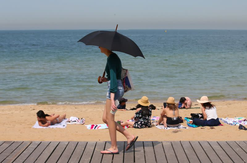 People flock to St Kilda beach as a heat wave sweeps across Victoria