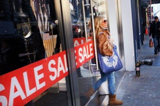 A woman exits a store in New York in 2011