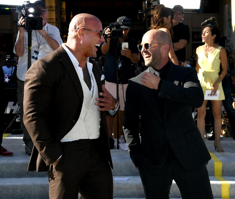 """HOLLYWOOD, CALIFORNIA - JULY 13: Dwayne Johnson (L) and Jason Statham arrive at the premiere of Universal Pictures' """"Fast & Furious Presents: Hobbs & Shaw"""" at Dolby Theatre on July 13, 2019 in Hollywood, California. (Photo by Kevin Winter/Getty Images)"""