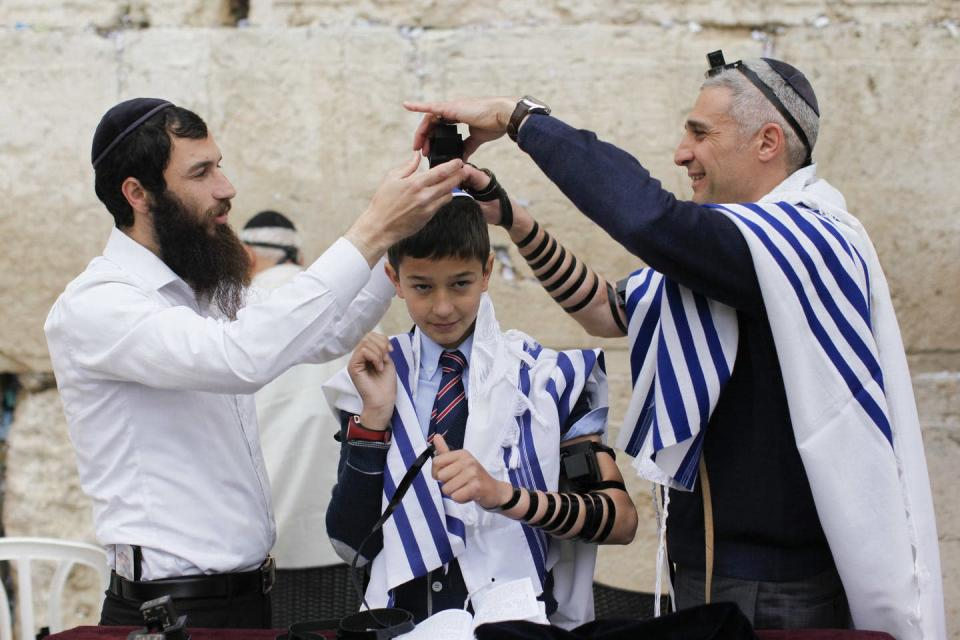 """<span class=""""caption"""">The Jewish ritual of bar mitzvah. which marks a 13-year-old young man's assumption of religious and legal obligations under Jewish law.</span> <span class=""""attribution""""><a class=""""link rapid-noclick-resp"""" href=""""https://www.flickr.com/photos/israelphotogallery/16977015801"""" rel=""""nofollow noopener"""" target=""""_blank"""" data-ylk=""""slk:Israel_photo_gallery"""">Israel_photo_gallery</a>, <a class=""""link rapid-noclick-resp"""" href=""""http://creativecommons.org/licenses/by-nd/4.0/"""" rel=""""nofollow noopener"""" target=""""_blank"""" data-ylk=""""slk:CC BY-ND"""">CC BY-ND</a></span>"""