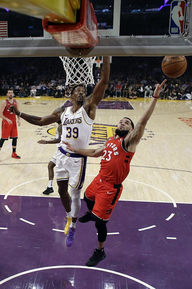 Toronto Raptors' Fred VanVleet, right, drives past Los Angeles Lakers' Dwight Howard (39) during the first half of an NBA basketball game Sunday, Nov. 10, 2019, in Los Angeles. (AP Photo/Marcio Jose Sanchez)