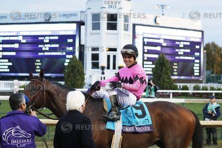 Nov 2, 2018; Louisville, KY, USA; Horse trainer Bob Baffert talks with jockey Joel Rosario aboard Game Winner (9) after winning the Sentient Jet Breeders Cup Juvenile at Churchill Downs. Mandatory Credit: Brian Spurlock-USA TODAY Sports
