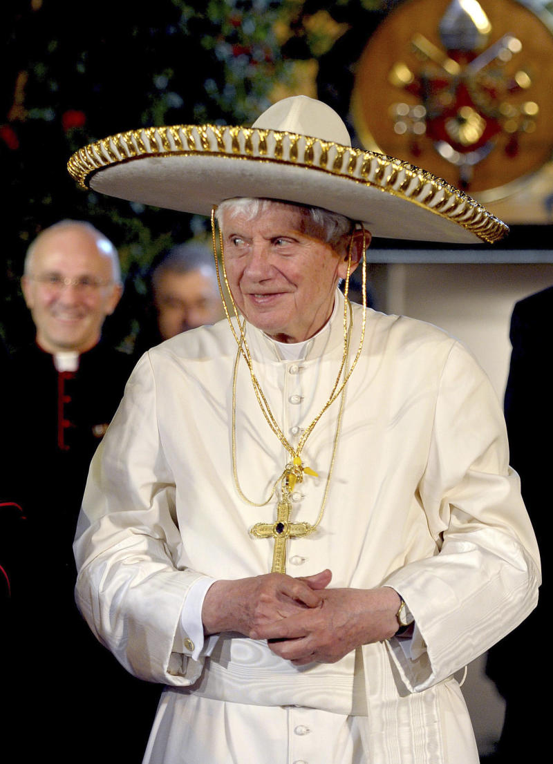 """FILE -- In this file picture made available on March 26, 2012 by the Vatican newspaper Osservatore Romano, Pope Benedict XVI wears a Mexican sombrero hat in Leon, Mexico, Sunday, March 25, 2012. Turin's  La Stampa newspaper reported Thursday, Feb. 14, 2014, that Benedict hit his head and bled when he got up in the middle of the night in an unfamiliar bedroom in Leon, Mexico. The report said blood stained his hair, pillow and floor. Vatican spokesman the Rev. Federico Lombardi confirmed the incident but said """"it was not relevant for the trip, in that it didn't affect it, nor in the decision"""" to resign. (AP Photo/Osservatore Romano)"""