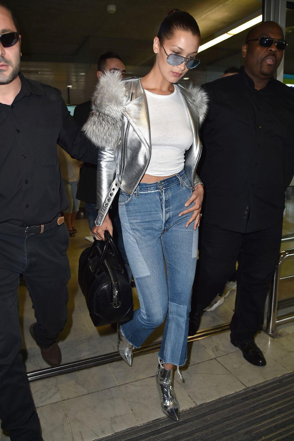 <p>In a silver Marc Jacobs moto jacket with patchwork frayed jeans, metallic ankle booties, a Givenchy handbag and aviator sunglasses while arriving at Nice airport in France. </p>