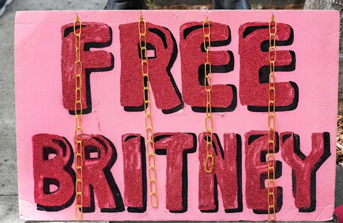 A placard is pictured in front of the courthouse during the FreeBritney movement rally in support of musician Britney Spears following a conservatorship court hearing in Los Angeles, California on April 27, 2021. - Britney Spears has requested to speak in court in the legal battle over her father's control of her affairs, her attorney said April 27, 2021. The 39-year-old US pop singer is the subject of a