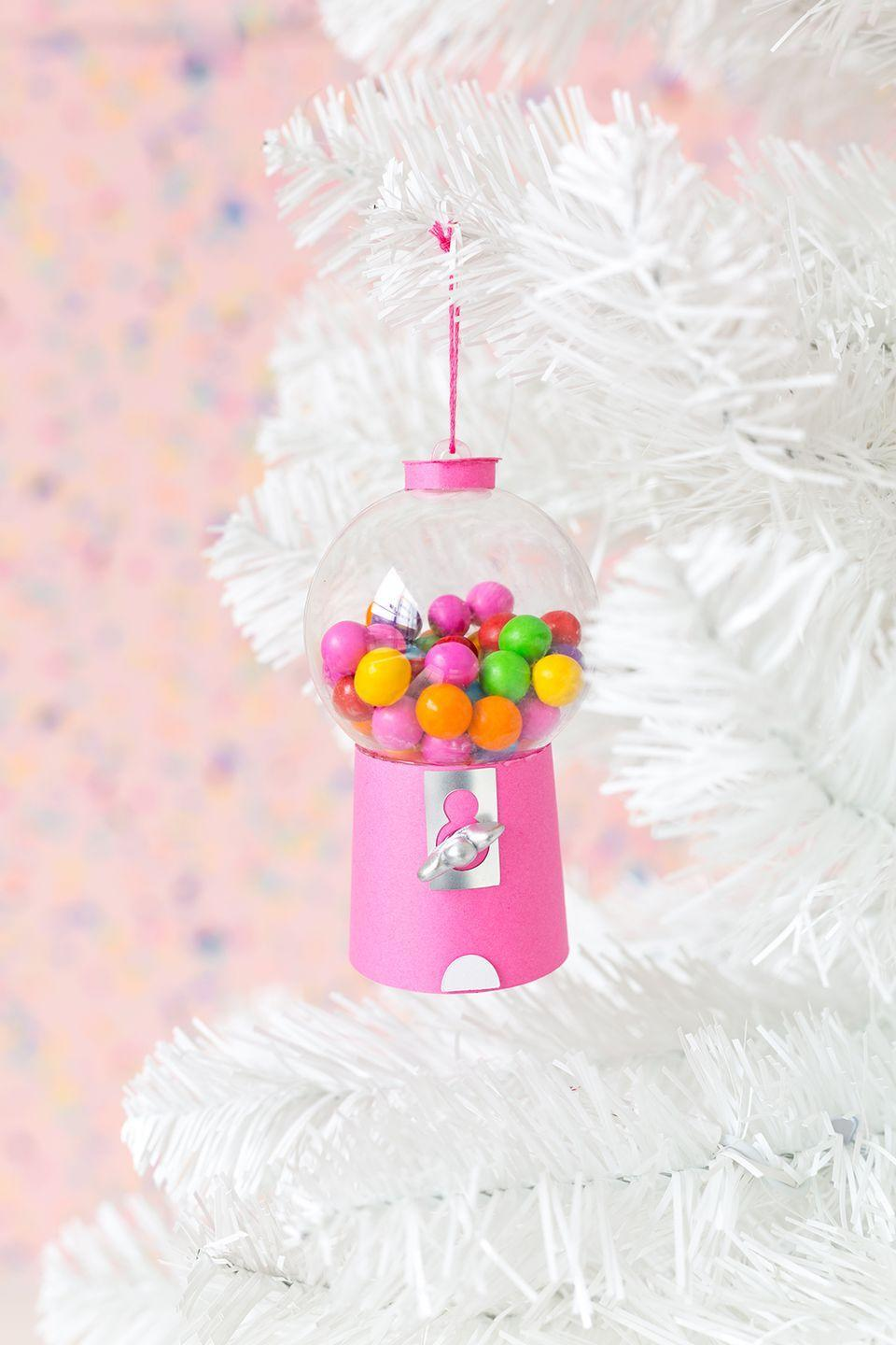 """<p>Another food-themed DIY that looks particularly good on novelty trees, like white and even pale pink. </p><p><em>Get the tutorial at <a href=""""http://www.awwsam.com/2017/11/diy-gumball-machine-ornaments.html"""" rel=""""nofollow noopener"""" target=""""_blank"""" data-ylk=""""slk:Aww Sam"""" class=""""link rapid-noclick-resp"""">Aww Sam</a>.</em></p><p><a class=""""link rapid-noclick-resp"""" href=""""https://www.amazon.com/Plastic-Ball-Ornament-60mm-Clear/dp/B00X8NRRPM/?tag=syn-yahoo-20&ascsubtag=%5Bartid%7C10072.g.34443405%5Bsrc%7Cyahoo-us"""" rel=""""nofollow noopener"""" target=""""_blank"""" data-ylk=""""slk:SHOP CLEAR BALL ORNAMENT"""">SHOP CLEAR BALL ORNAMENT</a></p>"""