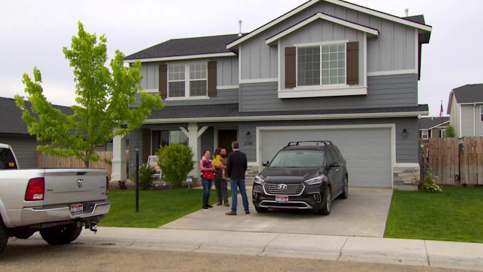 Californians Dustin and Brenda Heft bought this house in Boise without having set foot in it. / Credit: CBS News
