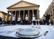 Cooks and restaurant owners protest against the government restriction measures to curb the spread of COVID-19, closing restaurants at night, at Rome's Pantheon Square, Wednesday, Oct. 28, 2020. (AP Photo/Alessandra Tarantino)
