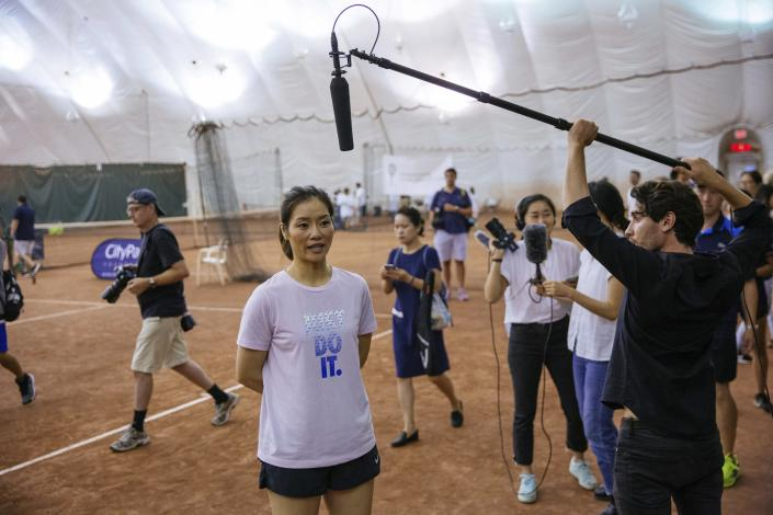 Two-time Grand Slam champion Li Na takes questions from the media at the Sutton East Tennis Club Thursday, July 18, 2019, in New York. Li Na will be inducted into the Tennis Hall of Fame on Saturday, July 20. (AP Photo/Kevin Hagen)