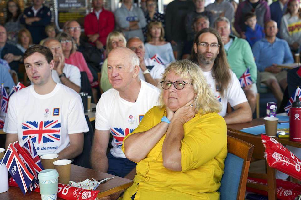 Eilidh McIntyre's fiance Jonny Forer (left), father Mike McIntyre, and mother Caroline McIntyre watch on the big screen at Hayling Island Sailing Club (Steve Parsons/PA) (PA Wire)
