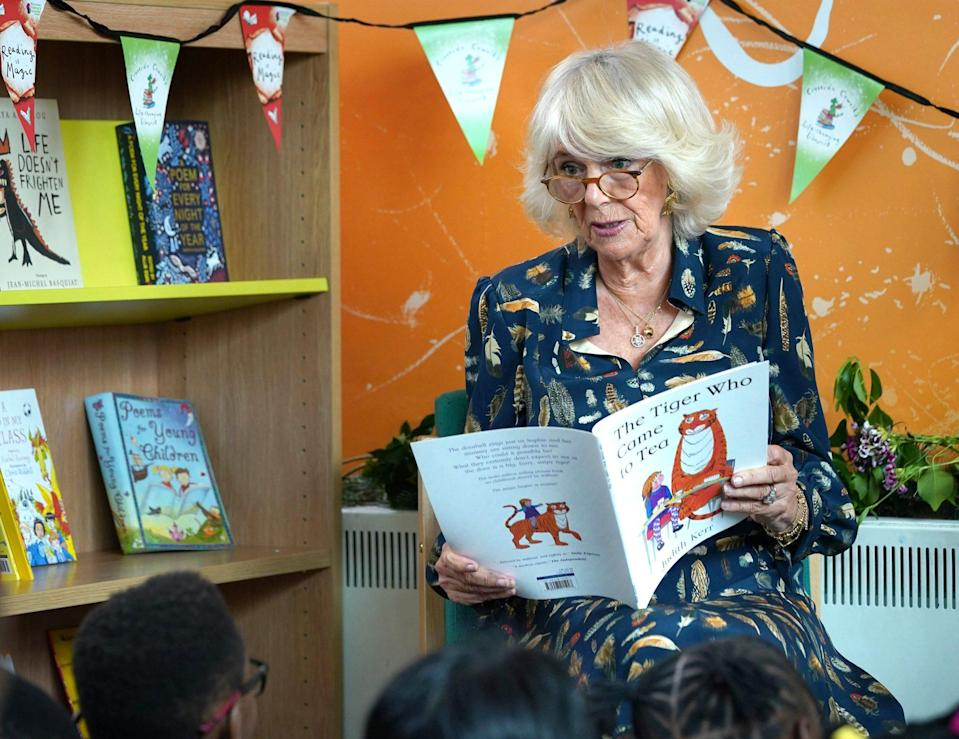 <p>Camilla, Duchess of Cornwall reads to children during her visit to Griffin Primary School to open the new Life-changing Library on June 22 in London.</p>