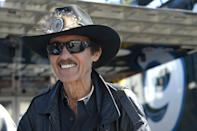 Car owner and and even-time NASCAR champion Richard Petty stands outside his hauler in the garage area during qualifying for the NASCAR Daytona 500 auto race at Daytona International Speedway in Daytona Beach, Fla., Sunday, Feb. 16, 2014. (AP Photo/Phelan M. Ebenhack)