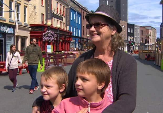 Madeline McCaul, right, says tourists still come to Newfoundland in the fall. (Curtis Hicks/CBC - image credit)