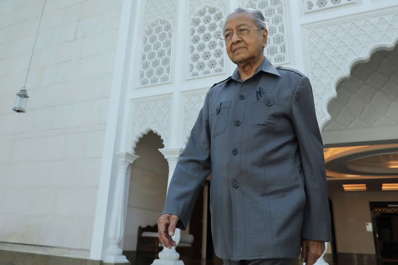 Malaysia's former Prime Minister Mahathir Mohamad leaves after an interview with Reuters in Kuala Lumpur