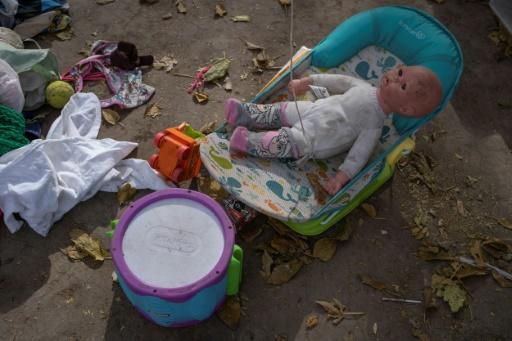 A baby doll is among the belongings left by those migrants who have abandoned the border camp