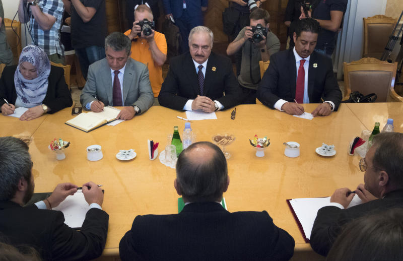 FILE - In this Aug. 14, 2017 file photo, Libyan militia commander General Khalifa Hifter, top center, listens to Russian Foreign Minister Sergei Lavrov, bottom center, during their meeting in Moscow, Russia. Officials in Libya's U.N.-backed administration say they plan to present evidence to Moscow of Russian mercenaries fighting alongside their adversary in their country's war. Libyan officials say up to 800 fighters from the Russian private security contractor Wagner Group have joined the forces of Hifter, the commander of forces battling for months trying to capture Libya's capital, Tripoli. (AP Photo/Ivan Sekretarev, File)