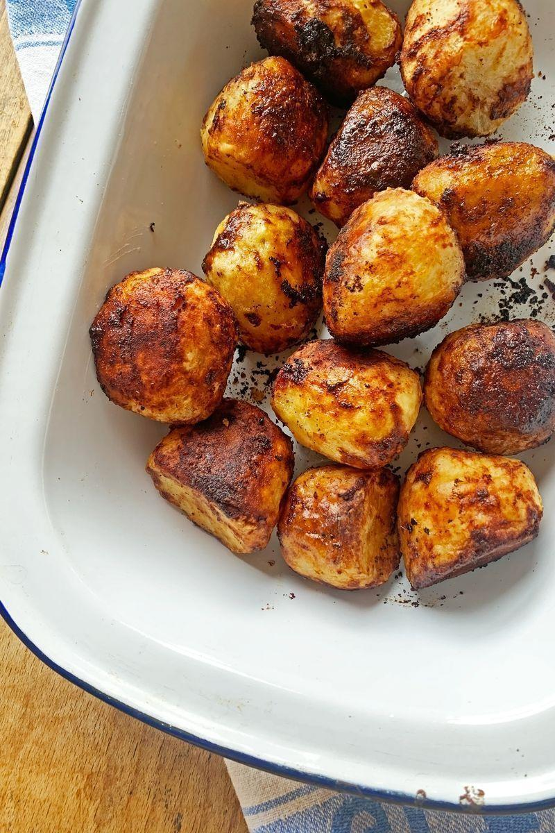 """<p><a href=""""https://www.delish.com/uk/food-news/a29456647/how-to-cook-roast-potatoes/"""" rel=""""nofollow noopener"""" target=""""_blank"""" data-ylk=""""slk:Roast potatoes"""" class=""""link rapid-noclick-resp"""">Roast potatoes</a> are one of the greatest food groups anyway, but adding <a href=""""https://www.delish.com/uk/food-news/a31345790/what-is-marmite/"""" rel=""""nofollow noopener"""" target=""""_blank"""" data-ylk=""""slk:Marmite"""" class=""""link rapid-noclick-resp"""">Marmite</a> into the mix and you've got yourself an absolute umami winner.</p><p>Get the <a href=""""https://www.delish.com/uk/cooking/recipes/a32048063/marmite-roast-potatoes/"""" rel=""""nofollow noopener"""" target=""""_blank"""" data-ylk=""""slk:Marmite Roasted Potatoes"""" class=""""link rapid-noclick-resp"""">Marmite Roasted Potatoes</a> recipe.</p>"""