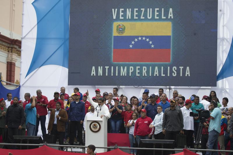 """Venezuela's President Nicolas Maduro speaks during a government rally in Caracas, Venezuela, Saturday, March 9, 2019. Demonstrators danced and waved flags on what organizers labeled a """"day of anti-imperialism"""" in a show of defiance toward the United States, which has imposed oil sanctions on Venezuela in an attempt to oust the president. (AP Photo/Ariana Cubillos)"""