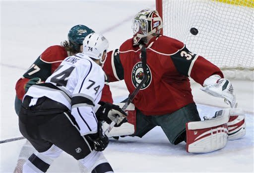 Los Angeles Kings' Dwight King (74) scores against Minnesota Wild goalie Niklas Backstrom of Finland in the first period of an NHL hockey game Tuesday, Feb. 28, 2012 in St. Paul, Minn. (AP Photo/Jim Mone)