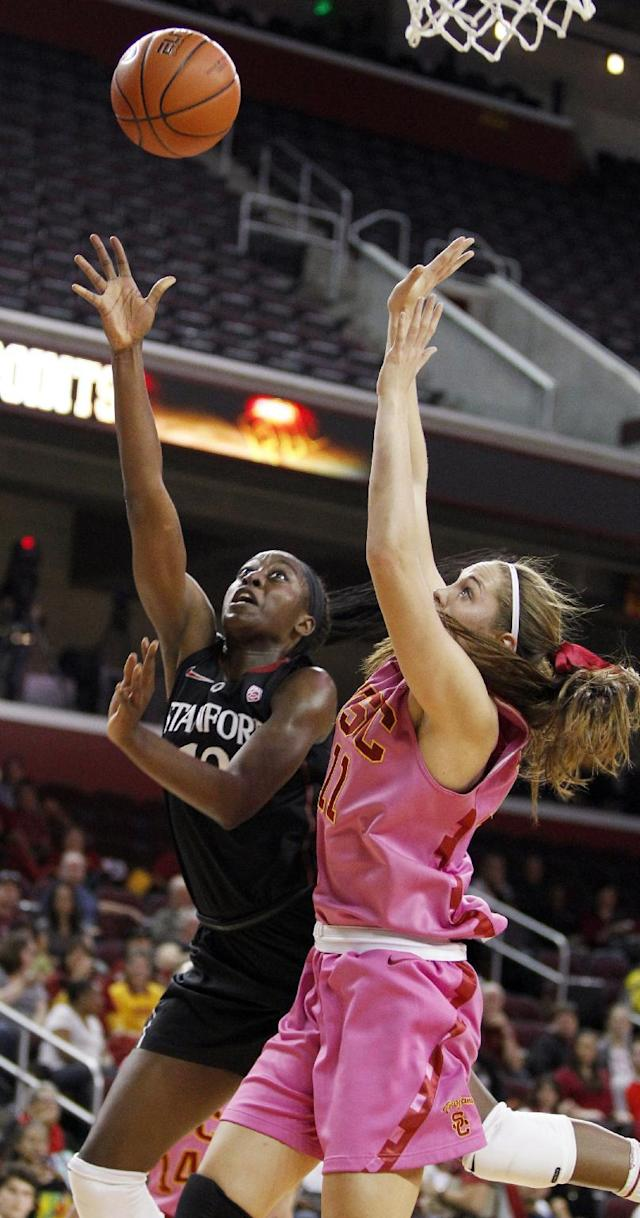 Stanford forward Chiney Ogwumike, left, releases a shot against Southern California forward Cassie Harberts (11) during the first half of an NCAA college basketball game Friday, Feb. 21, 2014, in Los Angeles. (AP Photo/Alex Gallardo)