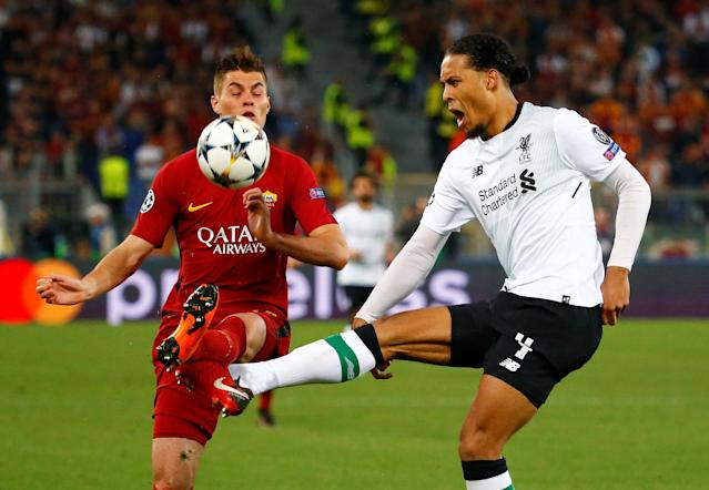 Soccer Football - Champions League Semi Final Second Leg - AS Roma v Liverpool - Stadio Olimpico, Rome, Italy - May 2, 2018 Liverpool's Virgil van Dijk in action with Roma's Patrik Schick REUTERS/Tony Gentile