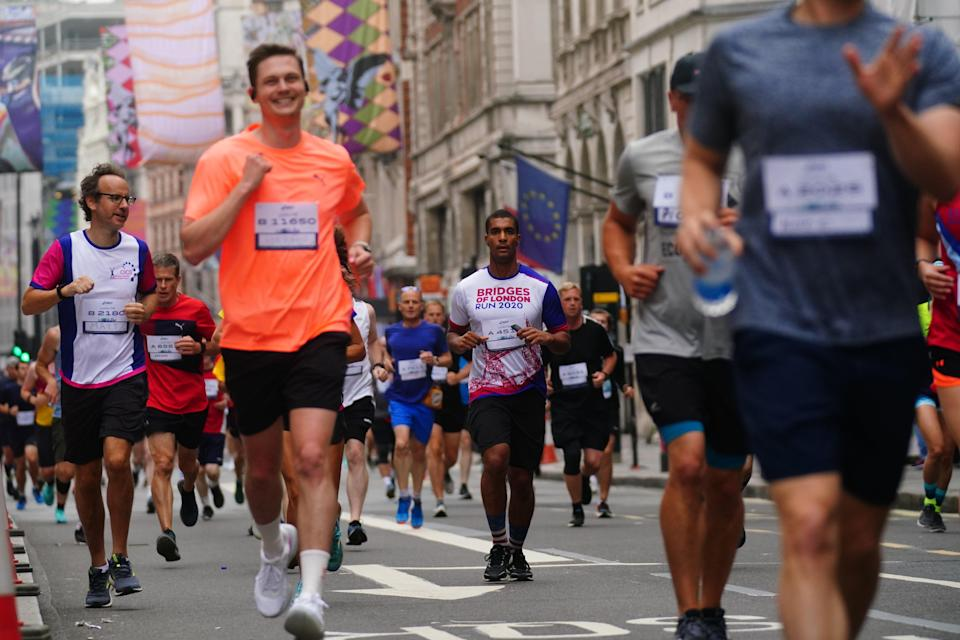 Runners in Piccadilly taking part in the Asics London 10k (Victoria Jones/PA) (PA Wire)