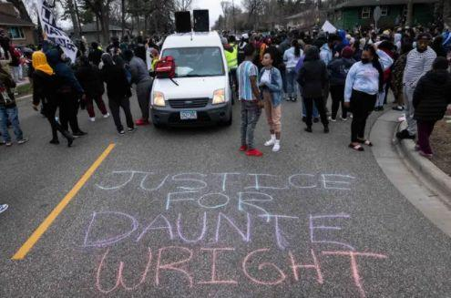 People gather in protest in Brooklyn Centre in the name of Duante Wright (Photo: PA)