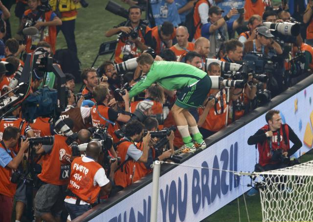 Germany's goalkeeper Manuel Neuer is seen amongst photographers after the 2014 World Cup final against Argentina at the Maracana stadium in Rio de Janeiro July 13, 2014. REUTERS/Paulo Whitaker (BRAZIL - Tags: WORLD CUP SPORT SOCCER)