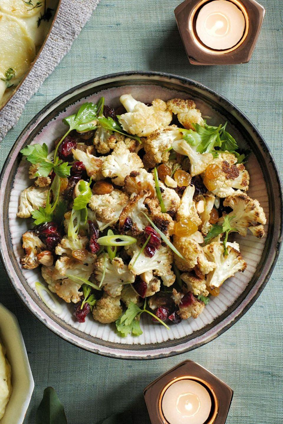"""<p>Move over, boring side salads. This warm and roasty cauliflower dish is hearty, delicious, and best of all — vegan!<br></p><p><em><a href=""""https://www.womansday.com/food-recipes/food-drinks/recipes/a60491/roasted-cauliflower-salad-recipe/"""" rel=""""nofollow noopener"""" target=""""_blank"""" data-ylk=""""slk:Get the recipe from Woman's Day »"""" class=""""link rapid-noclick-resp"""">Get the recipe from Woman's Day »</a></em></p><p><strong>RELATED: </strong><a href=""""https://www.goodhousekeeping.com/food-recipes/g3165/cauliflower-recipes/"""" rel=""""nofollow noopener"""" target=""""_blank"""" data-ylk=""""slk:30 Crazy-Delicious Cauliflower Recipes to Instantly Upgrade Your Veggie Game"""" class=""""link rapid-noclick-resp"""">30 Crazy-Delicious Cauliflower Recipes to Instantly Upgrade Your Veggie Game</a></p>"""