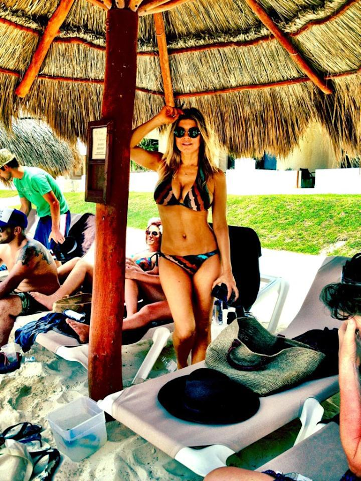 """Fergie showed off her her """"humps"""" in a multi-colored striped bikini while hanging at a beach in Mexico with friends and her hubby, Josh Duhamel, on Monday. """"Adios Cancun!"""" the Black Eyed Peas singer tweeted along with the sexy pic. (5/28/2012)"""