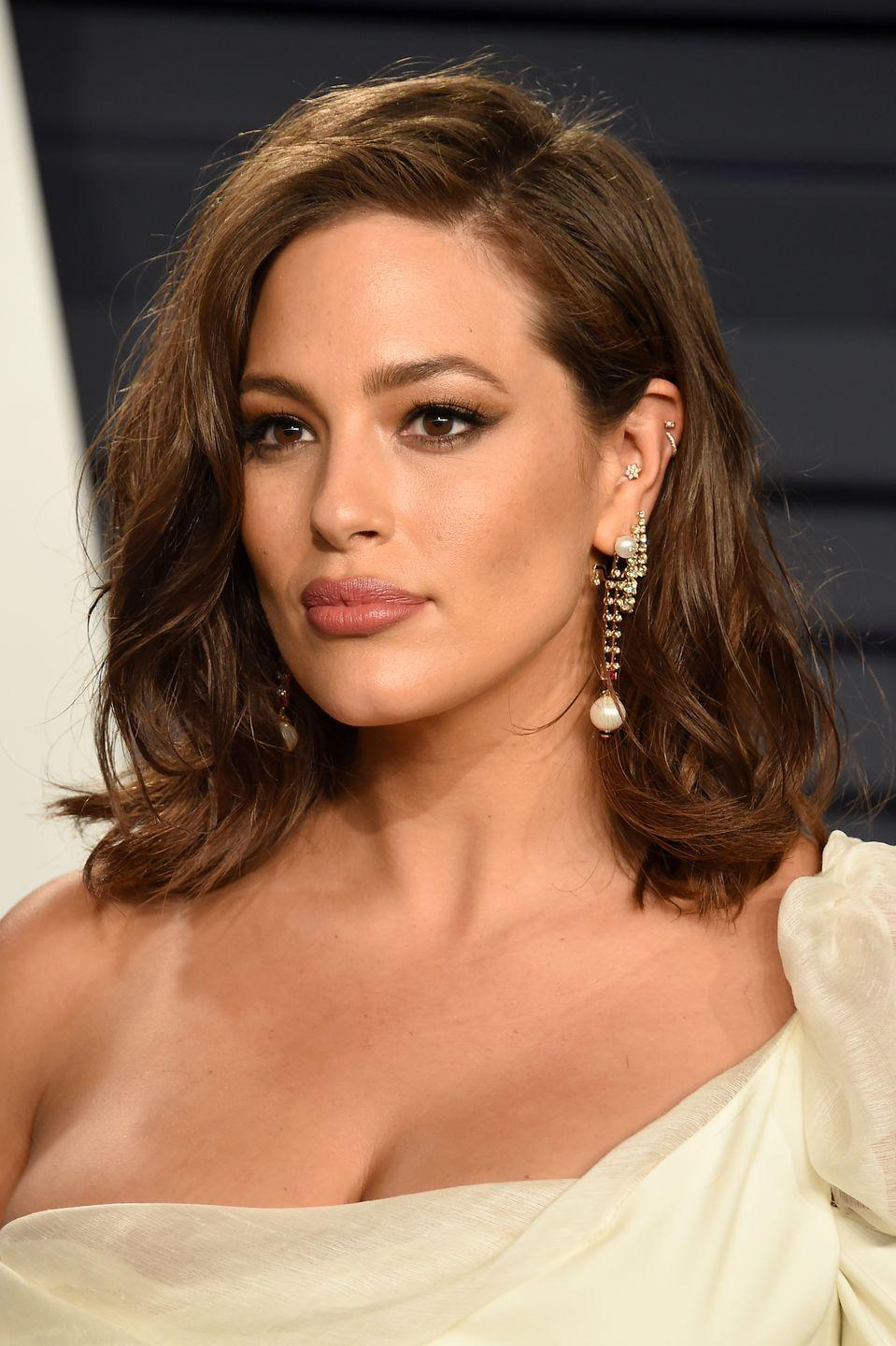 <p>The hoop and stud double helix piercing is so cool, not to mention that inner conch floral stud. Ashley Graham knows how to build a beautifully bejewelled stacked ear. </p>