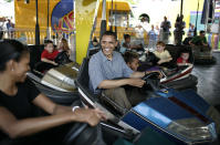 <p>On the bumper cars while visiting the Iowa State Fair while Barack was a Democratic Presidential Candidate [Photo: Getty] </p>
