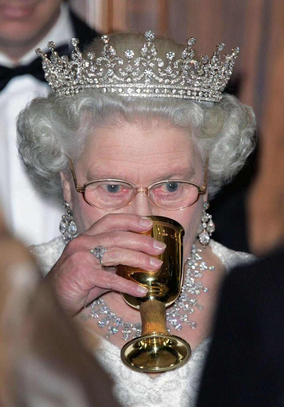 """<p>The royals don't just like to have a good drink at the holidays, said drink must be a stiff one. </p><p>""""They're not great drinkers, but the drinks are very strong,"""" royal expert, Ingrid Seward <a href=""""https://www.thesun.co.uk/fabulous/10510311/royal-family-christmas-tradition-queen-martini-prince-philip-tree/"""" rel=""""nofollow noopener"""" target=""""_blank"""" data-ylk=""""slk:reveals"""" class=""""link rapid-noclick-resp"""">reveals</a>. """"So any one that's a guest would be knocked out by these drinks.""""</p>"""